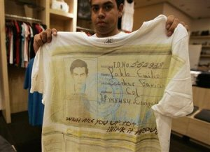 A salesperson shows a T-shirt with a picture of late Colombian cocaine kingpin Pablo Escobar at a store in Zapopan on the outskirts of Guadalajara September 28, 2012.