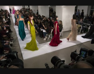 Models present creations from the Oscar De La Renta Autumn/Winter 2013 collection during New York Fashion Week