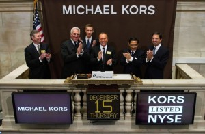 Michael Kors rings the opening bell at the New York Stock Exchange.